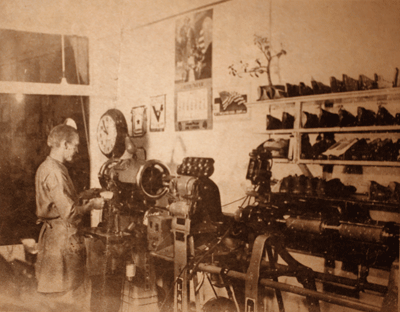 Photo of Clyde Olson repairing shoes.